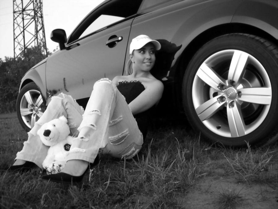 Audi-TT-8N-MK1-black-and-white-woman-sitting-next-to-car